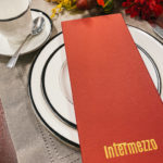 Italian restaurant logo foil stamped on fabric turn edge menu cover