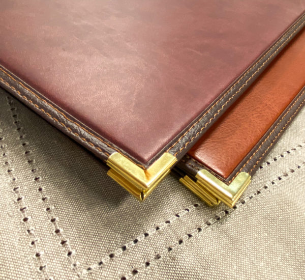 Detail of stitched edge menu with gold corners